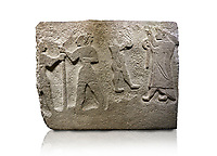 Alaca Hoyuk Hittite monumental relief sculpted orthostat stone panel. Andesite, Alaca, Corum, 1399 - 1301 B.C. Anatolian Civilizations Museum, Ankara, Turkey<br /> <br /> The rightmost figure wears a long coat and tailed dress. With both hands, he holds a sceptre with a ring in the middle. This item is thought to be a cult object in Assyria reliefs. The pointed and twisted tips of his shoes also show that he is in a high rank.  <br /> <br /> Against a white background.