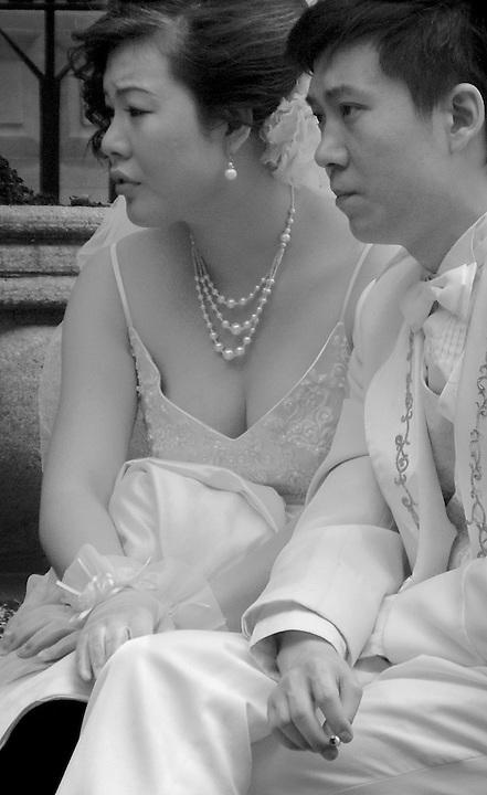 A Wedding Couple Awaits Their Turn With The Photographer. Shamian, Guangzhou, China.