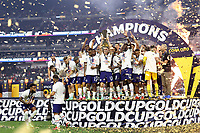 LAS VEGAS, NV - AUGUST 1: Matthew Hoppe #13 of the United States lifts the Gold Cup trophy after a game between Mexico and USMNT at Allegiant Stadium on August 1, 2021 in Las Vegas, Nevada.