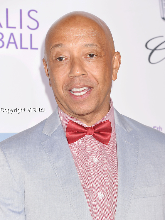 BRENTWOOD, CA - JUNE 11: Entrepreneur Russell Simmons arrives at the 15th Annual Chrysalis Butterfly Ball at a private residence on June 11, 2016 in Brentwood, California.