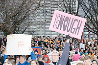 "A man holds a sign reading ""Enough"" as people gather during the March For Our Lives protest and demonstration in Boston Common in Boston, Massachusetts, USA, on Sat., March 24, 2018. The march was held in response to recent school gun violence."