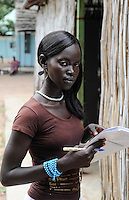 SOUTH SUDAN  Bahr al Ghazal region , Lakes State, village Mapourdit, Dinka Rachael Ayen Mayor doing a training at Radio Good News, wearing a wig / SUED-SUDAN  Bahr el Ghazal region , Lakes State, Dorf Mapourdit , Rachael Ayen Mayor macht ein Praktikum bei Radio Good News