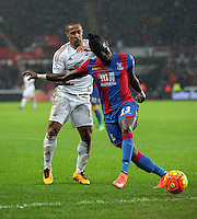 (L-R) Wayne Routledge of Swansea challenges Pape Souare of Crystal Palace during the Barclays Premier League match between Swansea City and Crystal Palace at the Liberty Stadium, Swansea on February 06 2016