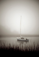 Sailboat anchored in a quiet harbor, Cape Cod, MA, USA