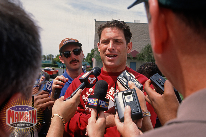 SANTA CLARA, CA:  Quarterback Steve Young of the San Francisco 49ers talks to the media including Matt Maiocco after practice at the Marie P. DeBartolo Sports Centre in Santa Clara, California on May 2, 1997. (Photo by Brad Mangin)