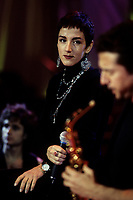 """Montreal (Qc) CANADA -November 1992 - File Photo -<br /> Spanish Group Mecano perform in Montreal for The Telethon of Stars :  a benefit event for sick children<br /> <br /> Mecano was a Spanish pop band whose debut coincided with La Movida Madrile??a, a sociocultural movement that occurred in Spain during the 1980s. Although Spanish music critics do not consider the band one of the most representative ensembles of the aforementioned cultural wave,[1] Mecano found more commercial success in the '80s and the early '90s, both in its native country and Latin America, France, and Italy with 25 million worldwide sales.[citation needed]. Most of the lyrics were written by one of the Cano brothers from a male perspective, and were mainly sung by Ana Torroja in a melodic, childlike voice while preserving that male perspective, which gave the group its distinctive, playful and sexually ambiguous style. Torroja's only lyricial contribution were the lyrics to the chorus of """"Mosquito""""."""