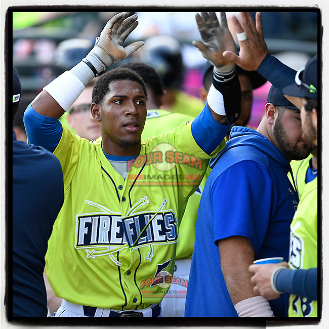 Center fielder Anthony Dirocie (5) of the Columbia Fireflies is greeted after scoring a run in a game against the Charleston RiverDogs on Saturday, April 6, 2019, at Segra Park in Columbia, South Carolina. Columbia won, 3-2. (Tom Priddy/Four Seam Images)