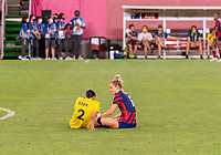 KASHIMA, JAPAN - AUGUST 5: Sam Kerr #2 of Australia sits on the field with Kristie Mewis #6 of the USWNT after a game between Australia and USWNT at Kashima Soccer Stadium on August 5, 2021 in Kashima, Japan.