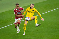 3rd October 2020; Riverside Stadium, Middlesbrough, Cleveland, England; English Football League Championship Football, Middlesbrough versus Barnsley; Cauley Woodrow of Barnsley FC and Marcus Tavernier of Middlesbrough FC compete for the ball