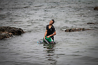 CEUTA, SPAIN ‐ MAY 19: A migrant Arrives to Tarajal beach, after having crossed the border between Morocco and Spain swimming on May 19, 2021 in Ceuta, Spain.  After a diplomatic conflict between Spain and Morocco, thousands of migrants who have taken advantage of the little Moroccan police activity on the border to cross it mainly by swimming, which has caused a migration crisis with the entry of more than 8000 migrants from the African country. (Photo by Joan Amengual/VIEWpress )