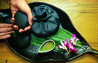 Pohaku stones used for Nonu ( noni ) treatment at a spa