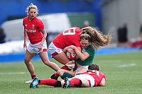 Beibhinn Parsons of Ireland is tackled by Hannah Jones of Wales  during the Women's Six Nations match between Wales and Ireland at Cardiff Arms Park, Cardiff, Wales, UK. Sunday 17 March 2019