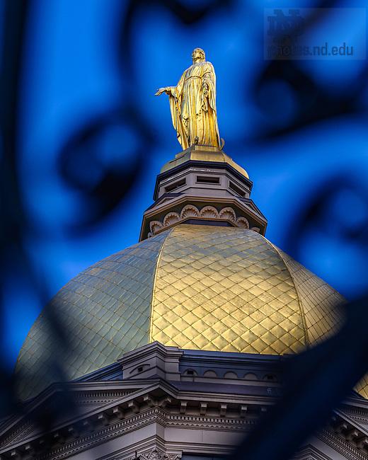 September 15, 2021; Golden Dome viewed through an ornamental wrought iron railing (Photo by Matt Cashore/University of Notre Dame)