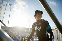 a smiling Geraint Thomas (GBR/SKY) getting onto the podium stage after winning the 58th E3 Harelbeke