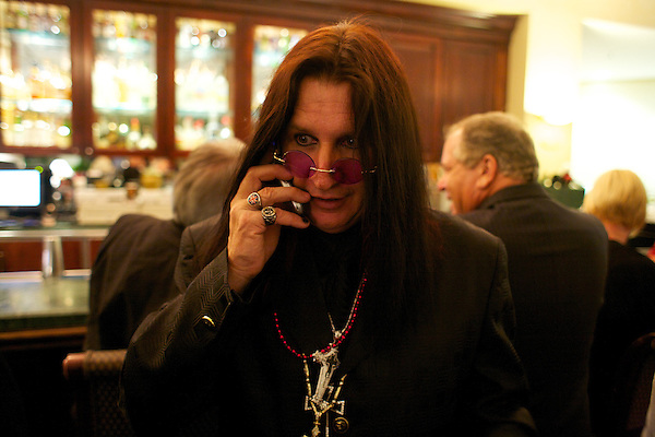 Ozzy Osbourne impersonator chats on his mobile phone at the Rosen Plaza Hotel bar during the Sunburst Convention of Professional Tribute Artists