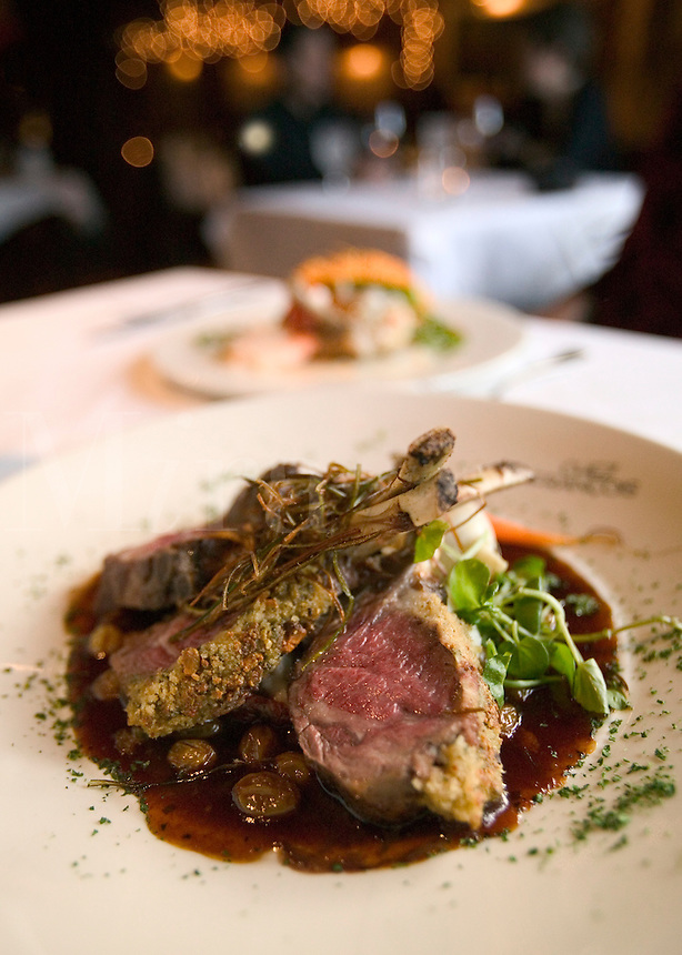 Lamb served on the bone with french provincial herbs