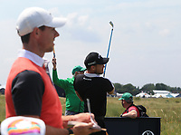 13th July 2021; The Royal St. George's Golf Club, Sandwich, Kent, England; The 149th Open Golf Championship, practice day; Rory McIlroy (NIR) looks on as Danny Willett (ENG) hits his tee shot on the 9th hole