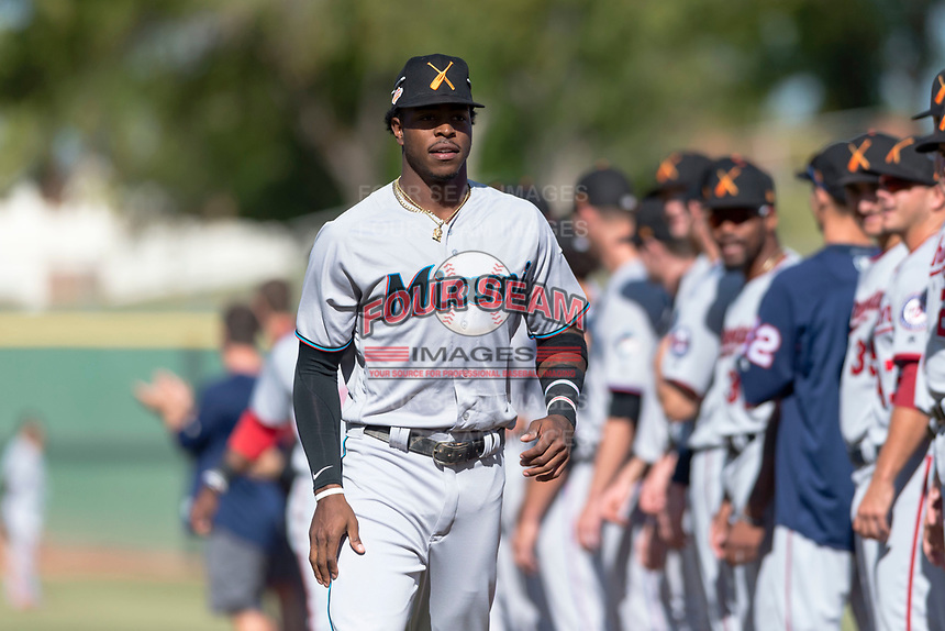 Salt River Rafters center fielder Monte Harrison (4), of the Miami Marlins organization, during player introductions before the Arizona Fall League Championship game against the Peoria Javelinas at Scottsdale Stadium on November 17, 2018 in Scottsdale, Arizona. Peoria defeated Salt River 3-2 in extra innings. (Zachary Lucy/Four Seam Images)