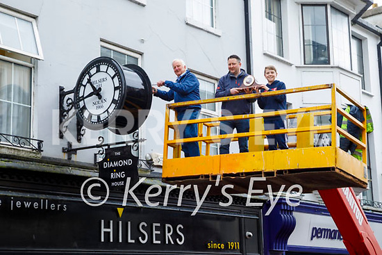 Billy and Will Nolan with Adam Lunn making the final adjustments to the clock as its been reinstalled at Nolan/Hilsers Jewellers on Sunday morning.