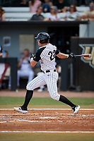 UCF Knights designated hitter Chandler Robertson (22) follows through on a swing during a game against the Siena Saints on February 17, 2019 at John Euliano Park in Orlando, Florida.  UCF defeated Siena 7-1.  (Mike Janes/Four Seam Images)
