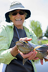 Jennifer Pahl holds the fish she caught during the the Casting for Recovery fishing clinic at Bently Ranch in Gardnerville, Nev. May 4, 2018.<br /> Photo by Candice Vivien/Nevada Momentum