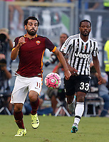 Calcio, Serie A: Roma vs Juventus. Roma, stadio Olimpico, 30 agosto 2015.<br /> Roma's Mohamed Salah, left, is chased by Juventus' Patrice Evra during the Italian Serie A football match between Roma and Juventus at Rome's Olympic stadium, 30 August 2015.<br /> UPDATE IMAGES PRESS/Riccardo De Luca