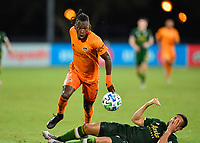 LAKE BUENA VISTA, FL - JULY 18: Alberth Elis #7 of the Houston Dynamo battles Bill Tuiloma #25 of the Portland Timbers as he tries to run onto a pass during a game between Houston Dynamo and Portland Timbers at ESPN Wide World of Sports on July 18, 2020 in Lake Buena Vista, Florida.