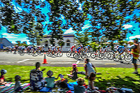 The peleton rides through Martinborough Square during stage three of the NZ Cycle Classic UCI Oceania Tour in Wairarapa, New Zealand on Tuesday, 24 January 2017. Photo: Dave Lintott / lintottphoto.co.nz