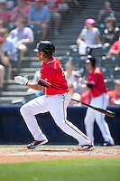 Myles Schroder (16) of the Richmond Flying Squirrels follows through on his swing against the Bowie Baysox at The Diamond on May 24, 2015 in Richmond, Virginia.  The Flying Squirrels defeated the Baysox 5-2.  (Brian Westerholt/Four Seam Images)