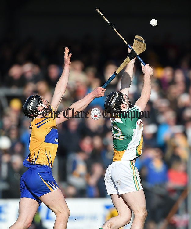 John Conlon of Clare in action against Sean Gardiner of Offaly during their Allianz Hurling League Div1b Round 1 game in Cusack park. Photograph by John Kelly.