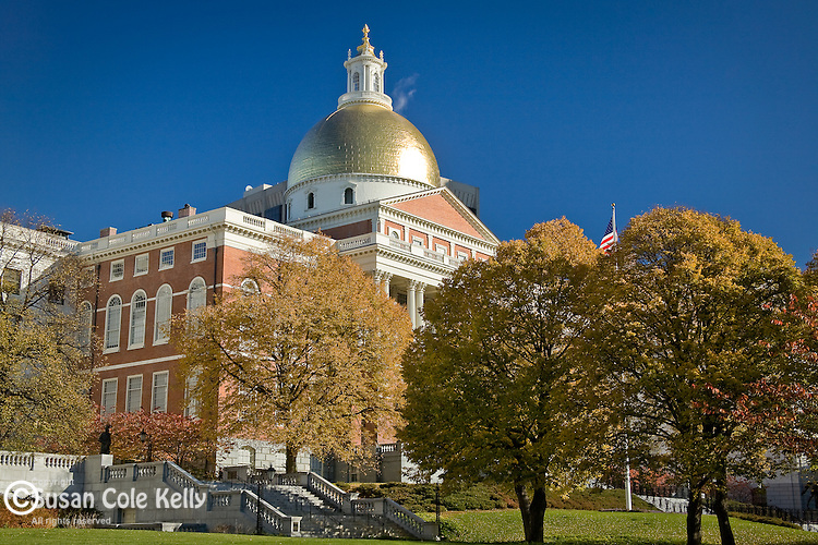 Fall foliage colors the Massachusetts State House on Boston Common in Boston, MA