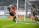 Berwick's Andrew McLean clears off the line before Raith's Brian Graham can knock the ball over the line.