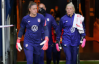 SOLNA, SWEDEN - APRIL 10: Alyssa Naeher #1 and Jane Campbell  #18  of the United States exit the tunnel before a game between Sweden and USWNT at Friends Arena on April 10, 2021 in Solna, Sweden.