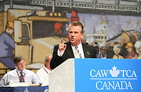 Ken Lewenza, CAW National President, gestures as he speaks during the opening  address on the first day of the 9th Constitutional Convention of the CAW-TAC at the Convention Centre in Quebec city, August 18, 2009.<br /> <br /> PHOTO :  Francis Vachon - Agence Quebec Presse