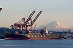 Seattle; Container Ship; Mount Rainier; Container Cranes; Elliott Bay; Puget Sound; Washington State. Hanjin, Korea, Korean companies,.