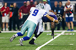 Dallas Cowboys quarterback Tony Romo (9) and Baltimore Ravens outside linebacker Courtney Upshaw (91) in action during the pre-season game between the Baltimore Ravens and the Dallas Cowboys at the AT & T stadium in Arlington, Texas. The Ravens lead Dallas 24 to 10 at half time.