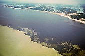 Manaus, Brazil. Aerial view of the Amazon River at the Meeting of the Waters (Encontro das Aguas). Amazonas State.