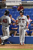 Brevard County Manatees third baseman Taylor Brennan (11) congratulates Clint Coulter (40) after hitting a home run during a game against the Dunedin Blue Jays on April 23, 2015 at Florida Auto Exchange Stadium in Dunedin, Florida.  Brevard County defeated Dunedin 10-6.  (Mike Janes/Four Seam Images)