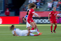 CARSON, CA - FEBRUARY 07: Jordyn Huitema #9 of Canada attempts to move with ball past Raquel Rodriguez #11 of Costa Rica during a game between Canada and Costa Rica at Dignity Health Sports Park on February 07, 2020 in Carson, California.