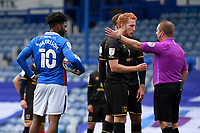Dean Lewington of Milton Keynes Dons middle has words with Referee Lee Swabey after a penalty was given during Portsmouth vs MK Dons, Sky Bet EFL League 1 Football at Fratton Park on 10th October 2020