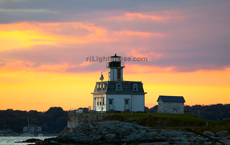The sky over Rose Island Lighthouse is painted by the setting sun.