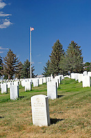 Rows of headstones mark the final resting place of United States military veterans at the Custer National Cemetery at the Little Bighorn National Monument in Wyoming.