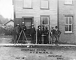 Hopedale OH:  Engineers and Surveyors posing for a progress photograph outside the company office. The Pittsburgh, Toledo, and Western Railroad Company, owned by the famous George J. Gould,  hired Brady Stewart to document the track and tunnel construction between Hopedale Ohio, and downtown Pittsburgh. Brady Stewart is second from right in the photo.