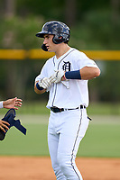 FCL Tigers West Izaac Pacheco (35) takes off his batting gloves after his first professional hit during a game against the FCL Yankees on July 31, 2021 at Tigertown in Lakeland, Florida.  (Mike Janes/Four Seam Images)