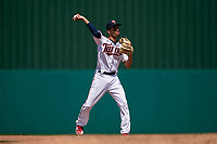 Minnesota Twins shortstop Andrelton Simmons (9) throws to first base during a Major League Spring Training game against the Pittsburgh Pirates on March 16, 2021 at Hammond Stadium in Fort Myers, Florida.  (Mike Janes/Four Seam Images)