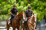 ELMONT, NY - JUNE 07: Justify with Humberto Gomez aboard is ponied off the track by Jimmy Barnes after completing preparations for the 150th Belmont Stakes at Belmont Park on June 07, 2018 in Elmont, New York. (Photo by Alex Evers/Eclipse Sportswire/Getty Images)