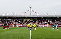 A minutes silence for the Airshow crash in shoreham prior to the Sky Bet League 2 match between Crawley Town and Wycombe Wanderers at Checkatrade.com Stadium, Crawley, England on 29 August 2015. Photo by Liam McAvoy.