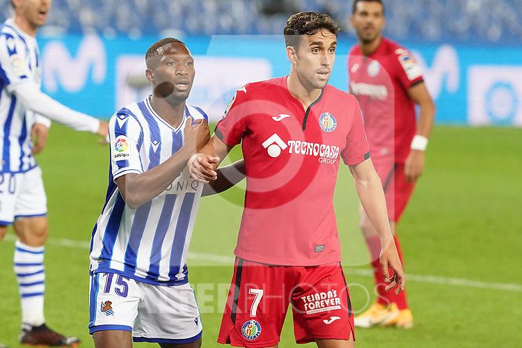 Real Sociedad's Modibo Sagnan (l) and Getafe CF's Jaime Mata during La Liga match. October 3, 2020. (ALTERPHOTOS/Acero)