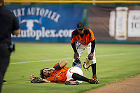 AZL Giants right fielder Diego Rincones (35) grimaces in pain after a collision with second baseman Robert Antunez (34) during the game against the AZL Reds on August 12, 2017 at Scottsdale Stadium in Scottsdale, Arizona. AZL Giants defeated the AZL Reds 1-0. (Zachary Lucy/Four Seam Images)