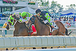Raging Daoust, Victor Santiago up, wins the GIII Salvator Mile at Monmouth Park in Oceanport, New Jersey.